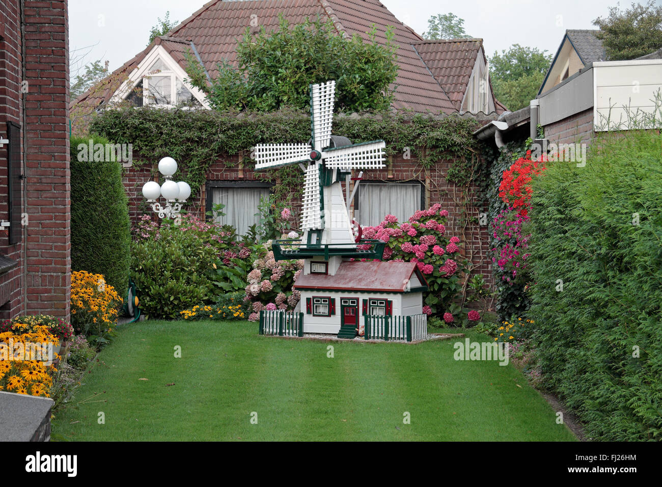 Ornate Garden Ornament In The Shape Of A Windmill In A Garden In Uden,  Noord Brabant, Netherlands.