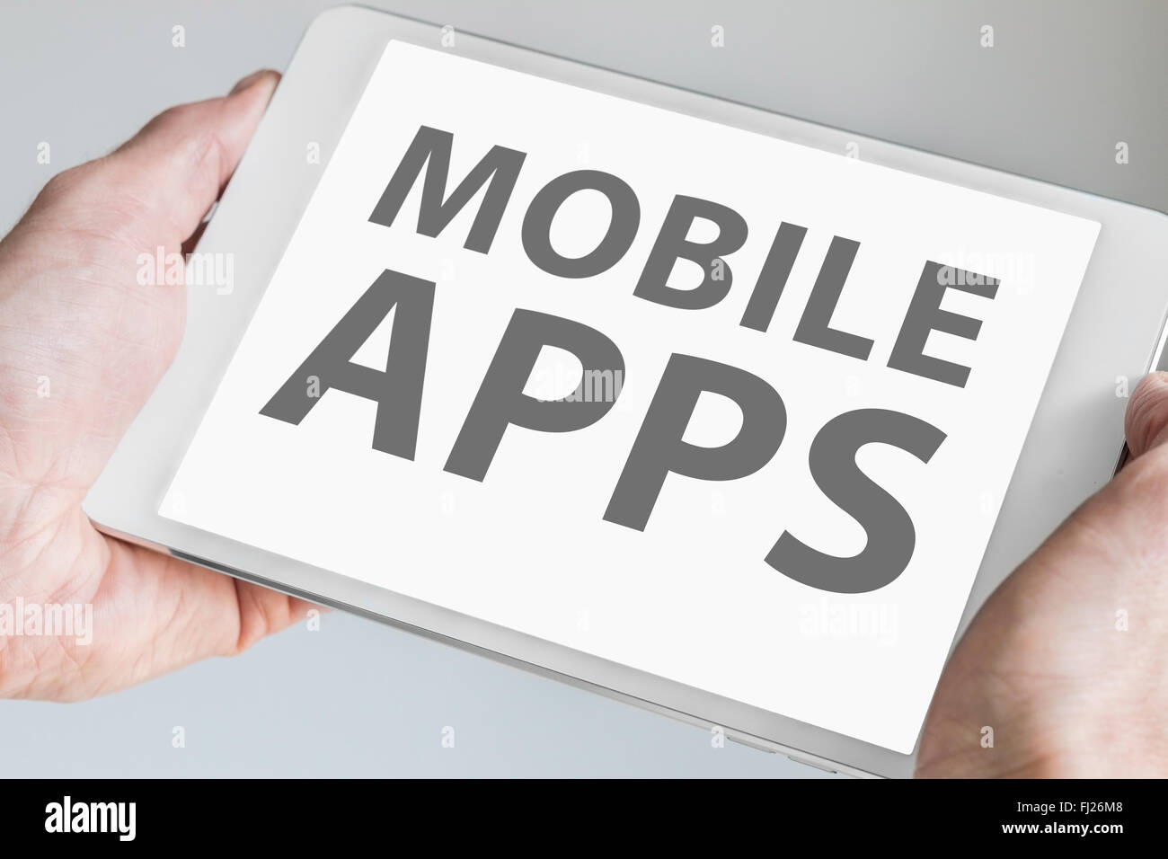 Mobile apps text displayed on touchscreen of modern tablet or smart device. Concept for development of applications - Stock Image