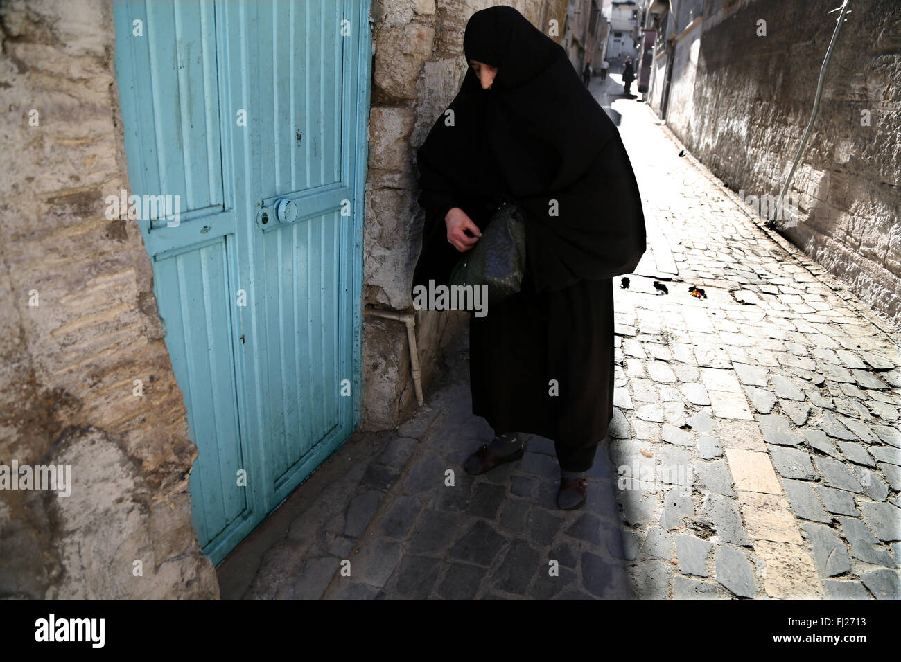 Old woman wearing niqab  in the streets of Sanliurfa Turkey - Stock Image