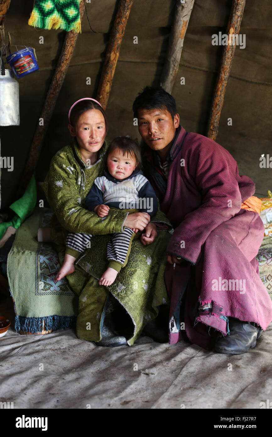 Tsaatan nomads family inside their ger in Mongolia - Stock Image