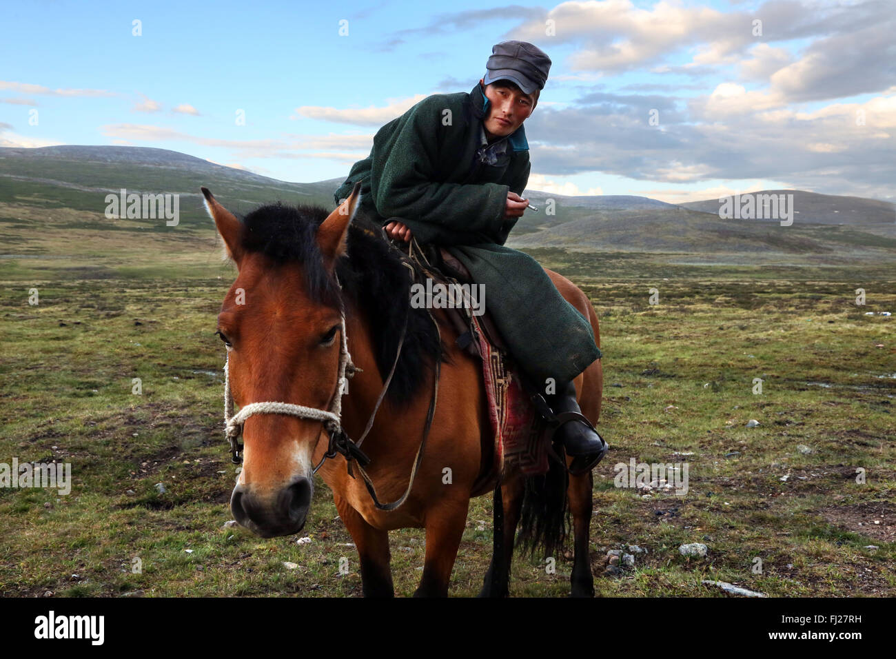 Young man on horse, , Tsaatan Dukha people , nomadic reindeer herders , Mongolia - Stock Image