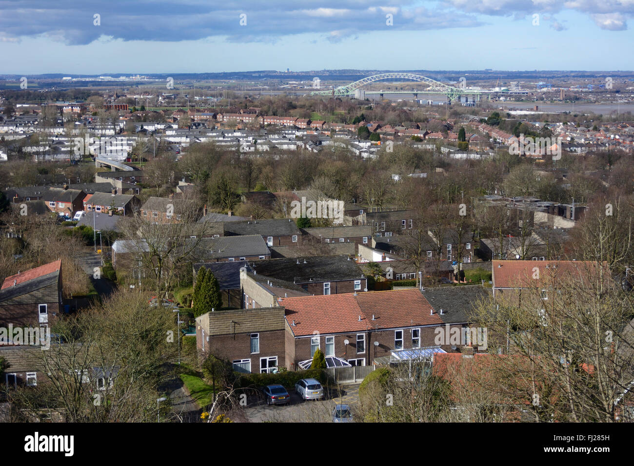 The town of Runcorn on the bank of the River Mersey and opposite the town of Widnes. The Runcorn -Widnes bridge - Stock Image