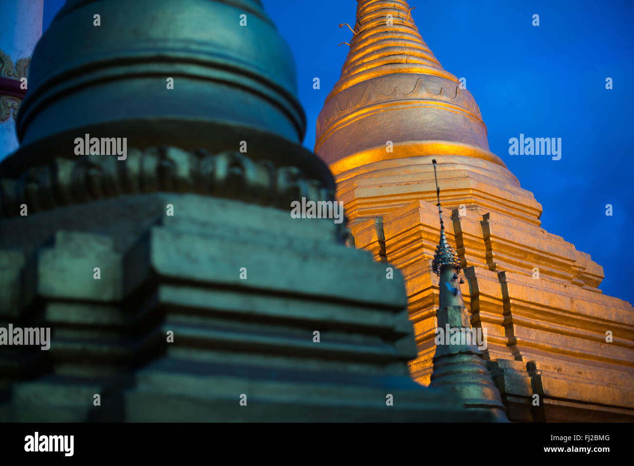 MANDALAY, Myanmar - Sitting on top of Mandalay Hill, Sutaungpyei Pagoda features a large ornately decorate patio - Stock Image