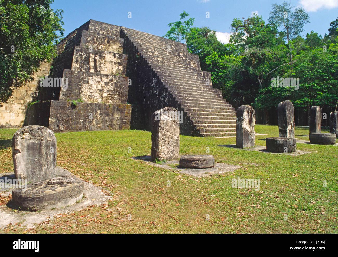 MAYA RUINS and stairway with STELAE & ALTERS to MAYA RULERS of TIKAL - PETEN JUNGLE, GUATEMALA - Stock Image