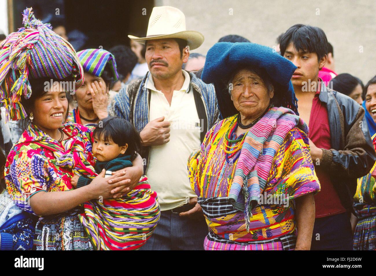 INDIGENOUS PEOPLE in TRADITIONAL DRESS watch LA MERCED CHURCH GOOD FRIDAY PARADE - ANTIGUA, GUATAMALA - Stock Image