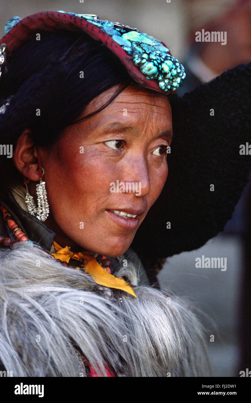 LADAKHI WOMAN showing familial wealth via her PERAK, traditional head piece of silver, coral and TURQUOISE - LADAKH, - Stock Image