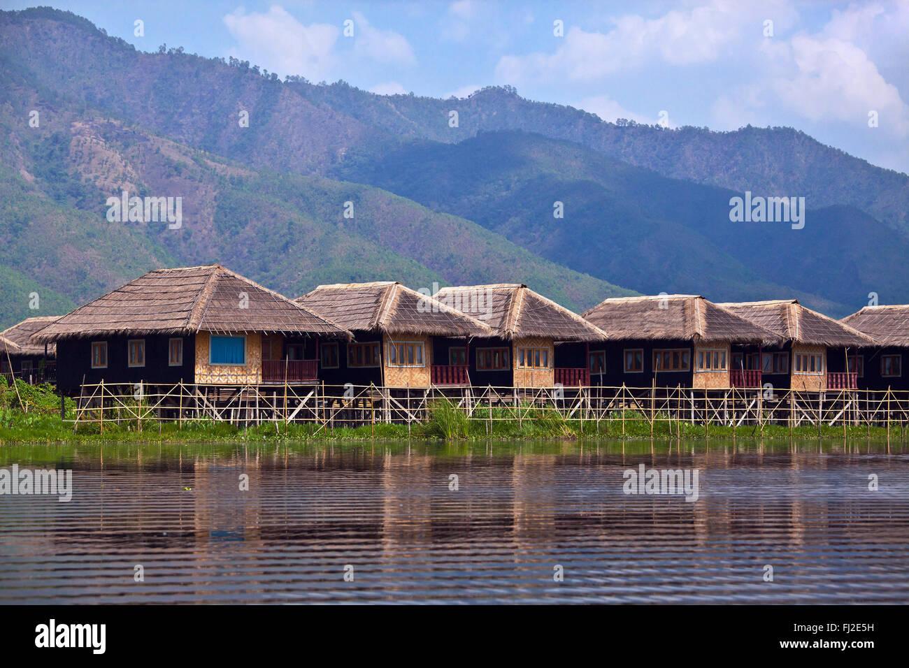 SKY LAKE RESORT consists of individual bungalos built on stilts on INLE LAKE - MYANMAR - Stock Image