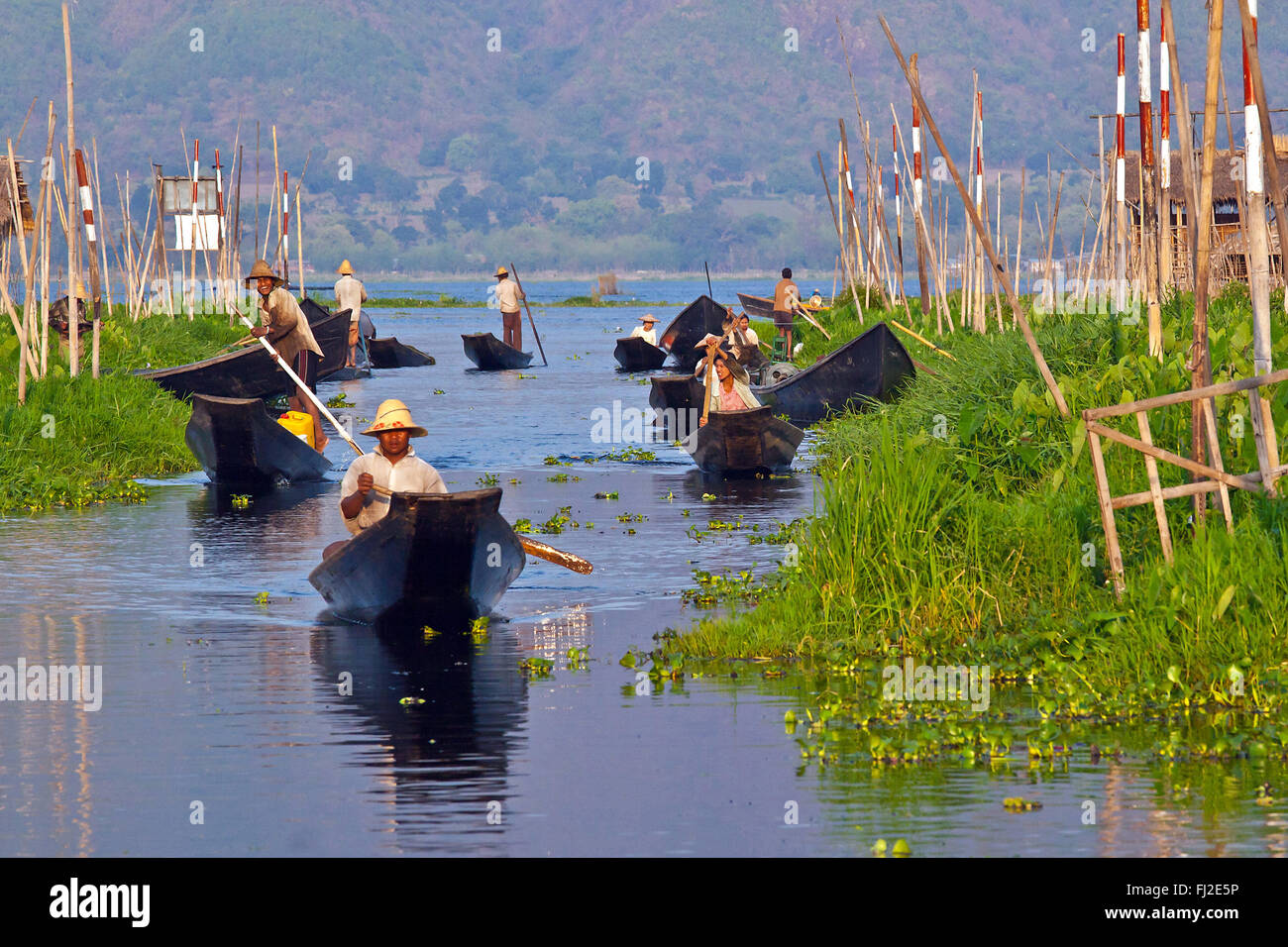 Hand made WOODEN BOATS are the main form of transportation on INLE LAKE - MYANMAR - Stock Image