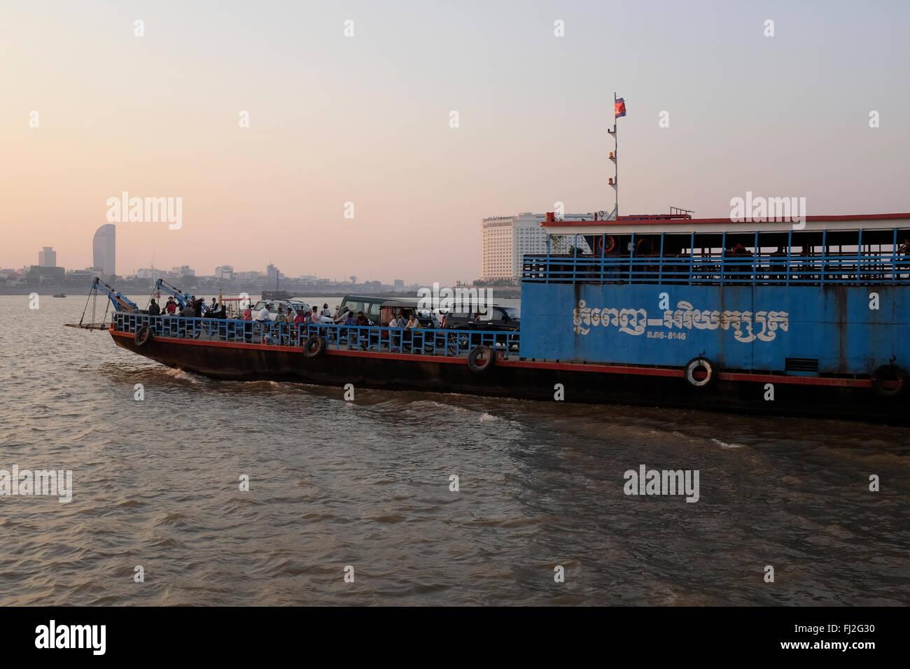 Car ferry heading into Phnom Penh, Cambodia - Stock Image