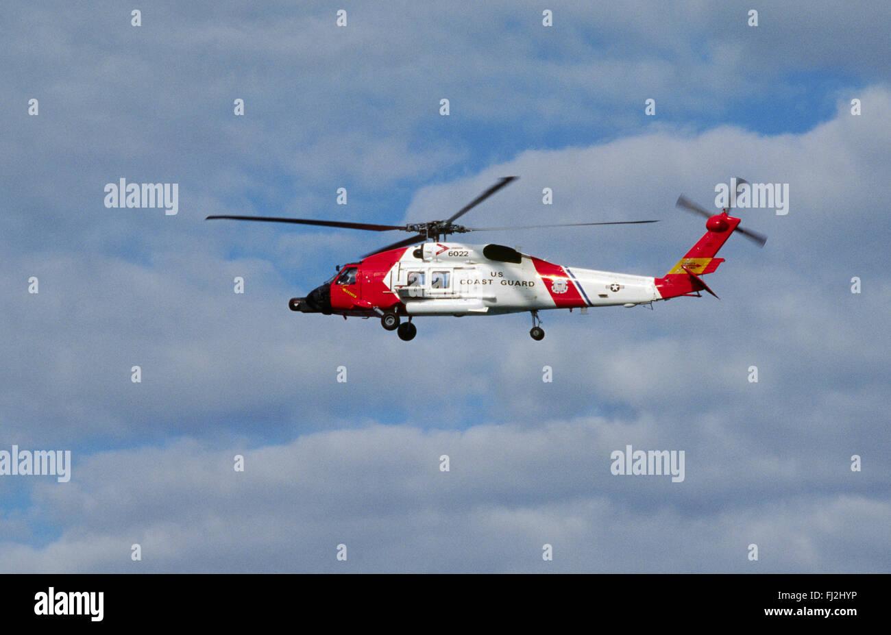 US COASTGUARD HELICOPTER over Glacier Bay - ALASKA - Stock Image