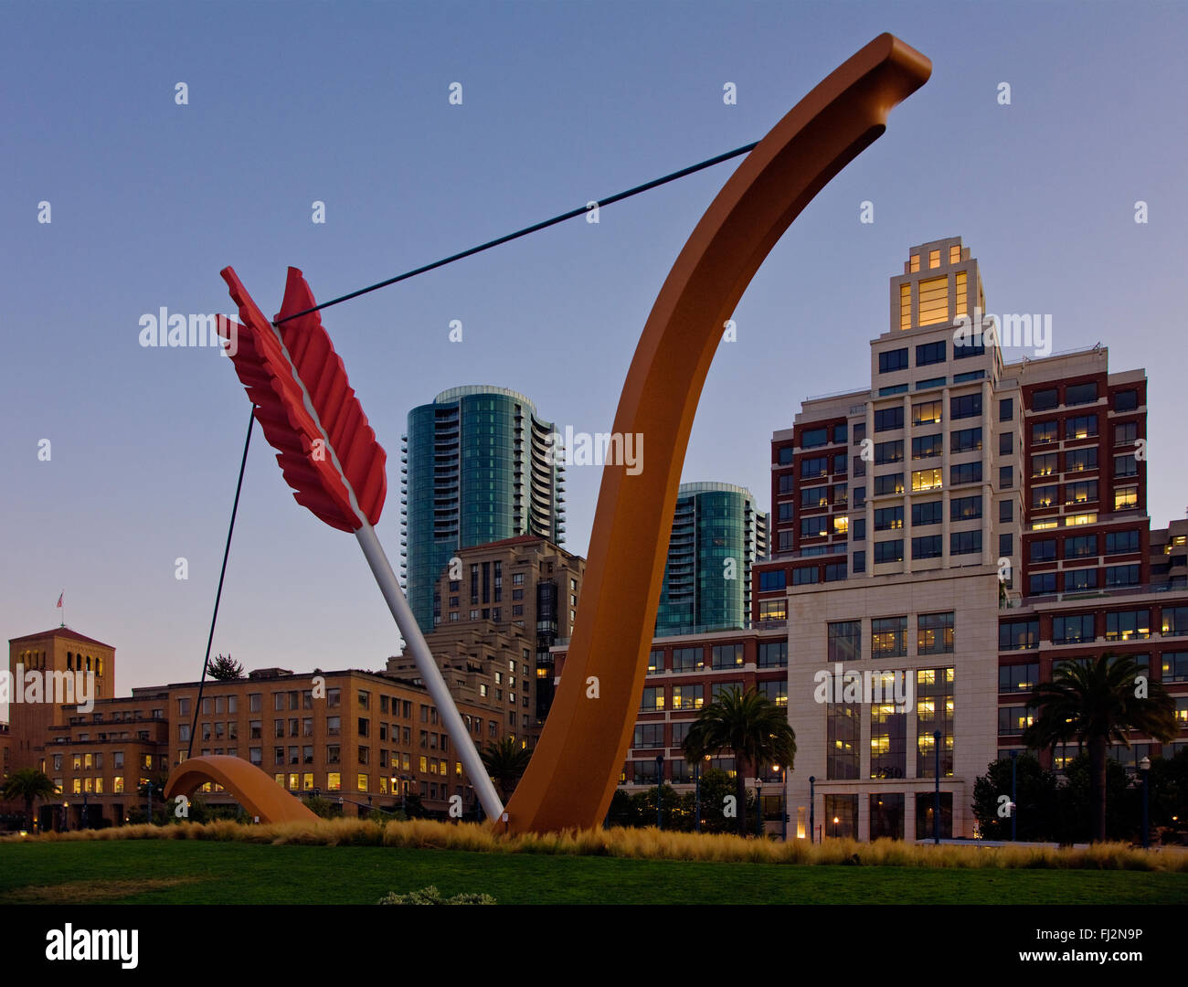 CITYSCAPE and Claes Oldenburgs sculpture titled CUPIDS SPAN in RINCON PARK on THE EMBARCADERO - SAN FRANCISCO, CALIFORNIA - Stock Image