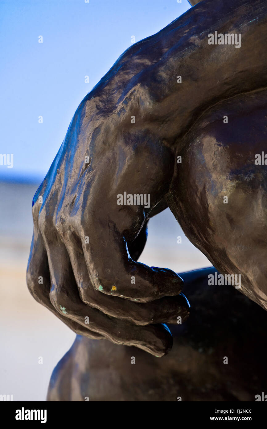 The hand of the Auguste Rodin sculpture titled THE THINKER inthe  courtyard of the LEGION OF HONOR - SAN FRANCISCO, - Stock Image