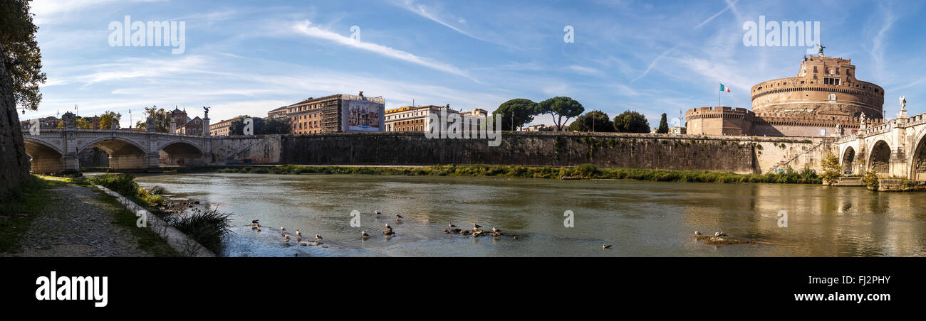 View of Tiber River with Ponte Sant'Angelo along Rome City, with the view of Castel Sant'Angelo, Castle - Stock Image