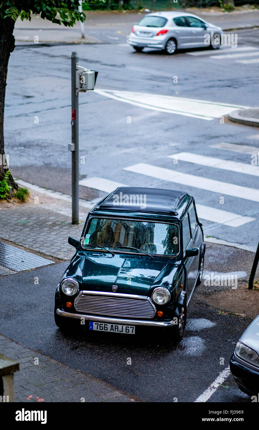 Dark green Mini car parked on pavement, Strasbourg, Alsace, France - Stock Image