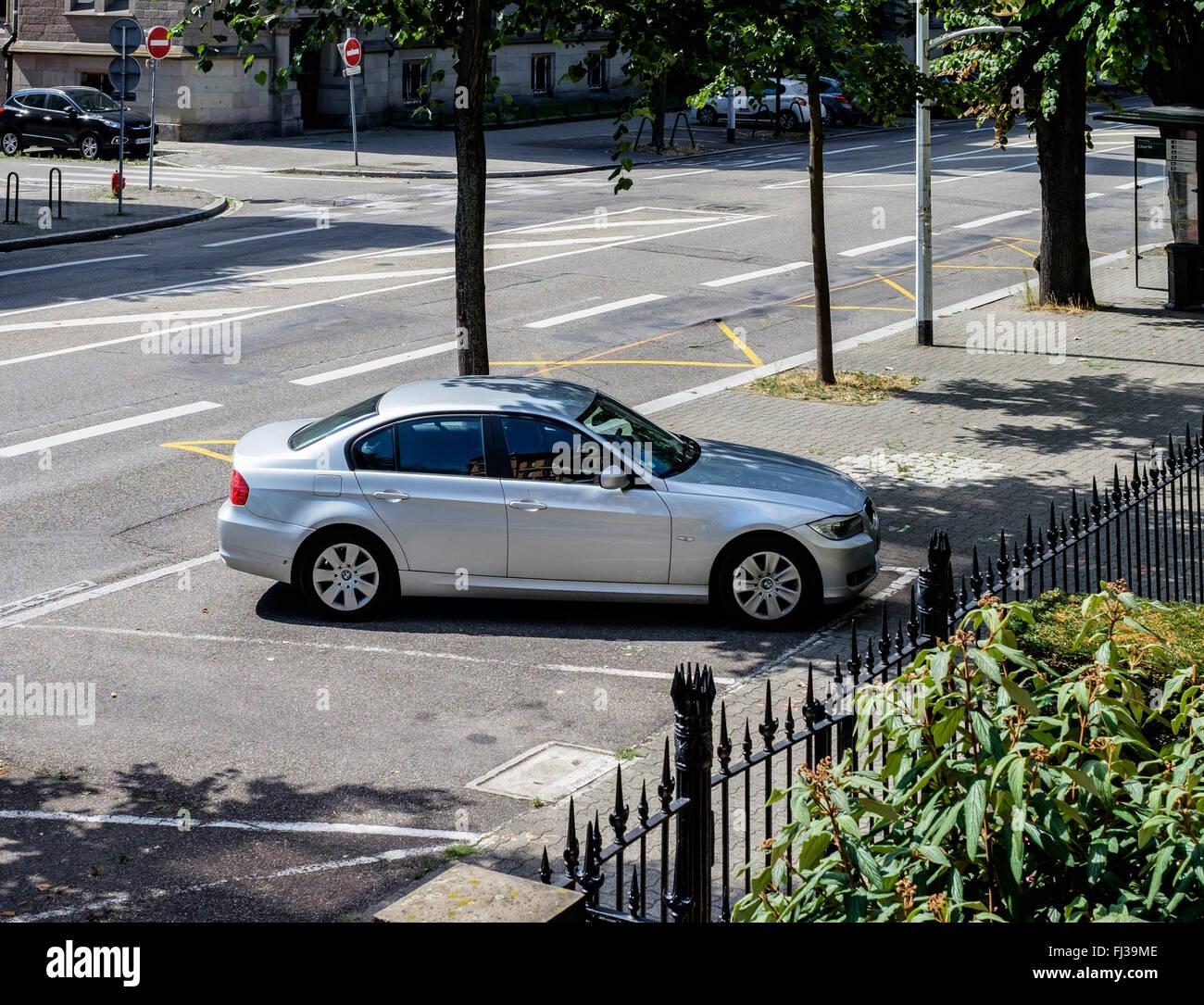 Car parked on pavement, Strasbourg, Alsace, France - Stock Image