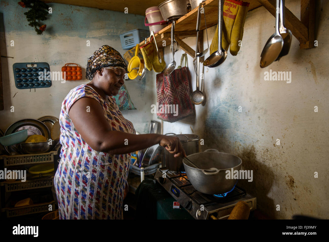 Woman cooking in kitchen, Cameroon, Africa - Stock Image