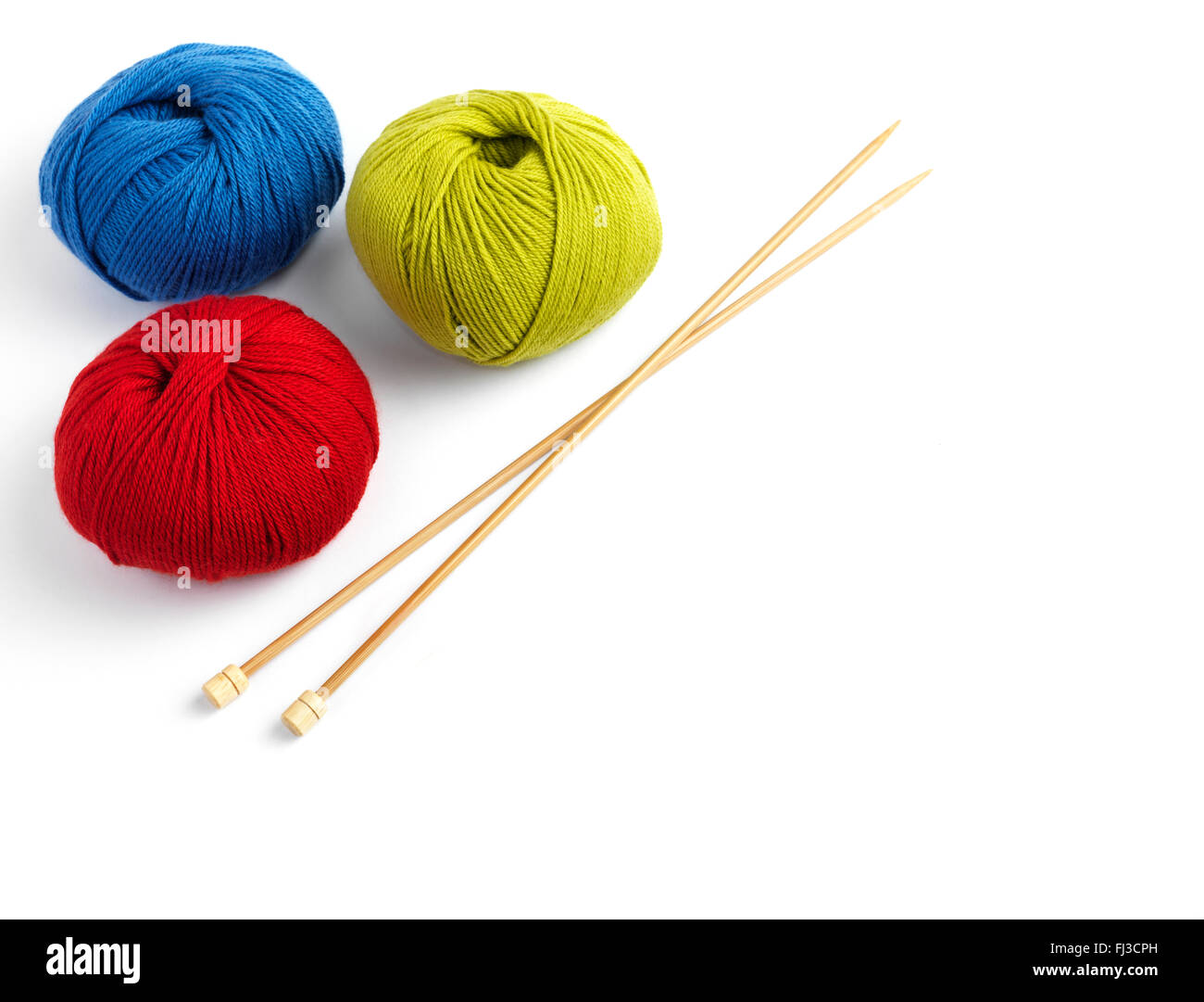 Balls of wool and a knitting needle - Stock Image