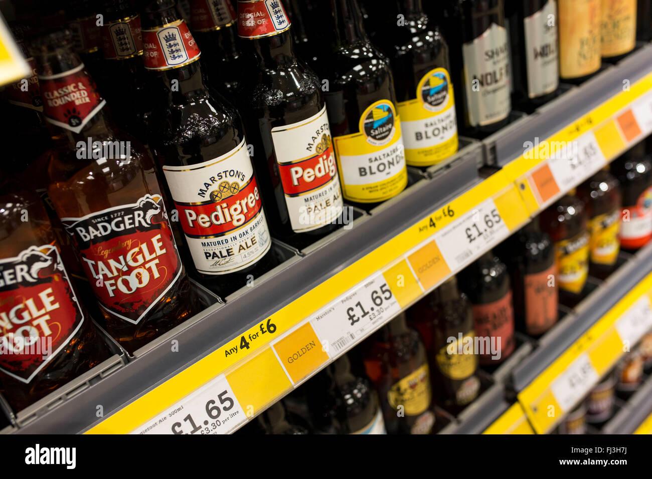 Beer on supermarket shelves - Stock Image