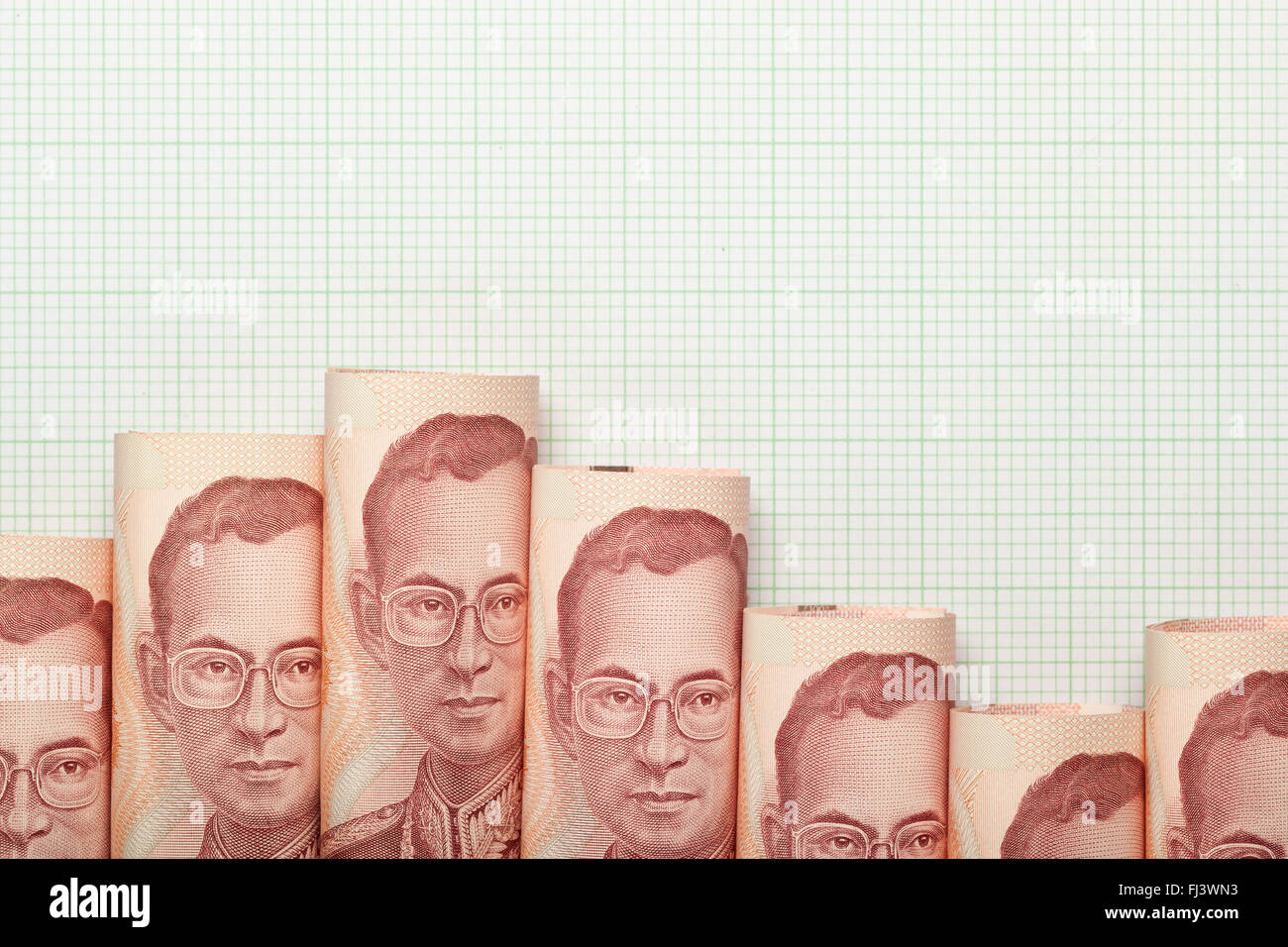 Thai currency forming a downtrend graph Stock Photo