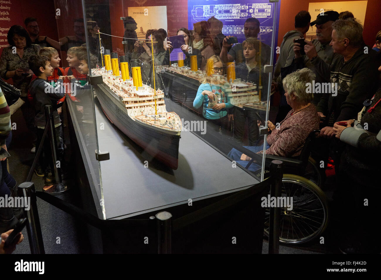A visitor looks at authentic objects from the Titanic at the exhibition Titanic: The Artifact Exhibition  Prague - Stock Image