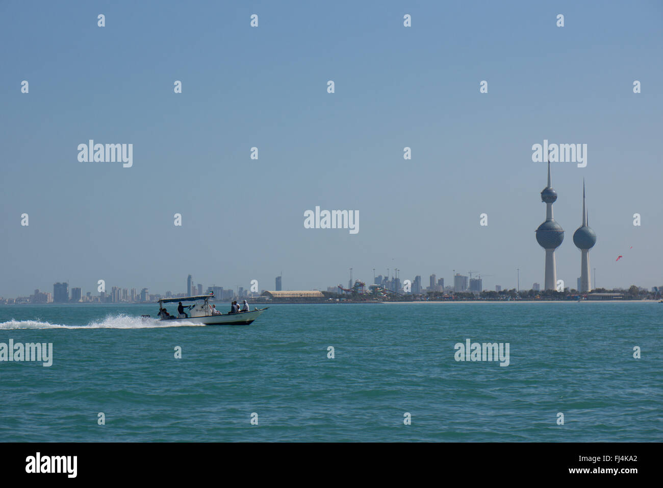 A speed boat passes the Kuwait towers - Stock Image