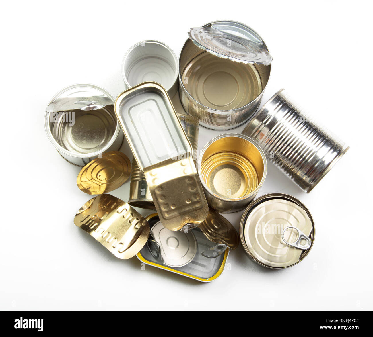 Pile of tin cans waiting to reuse. - Stock Image