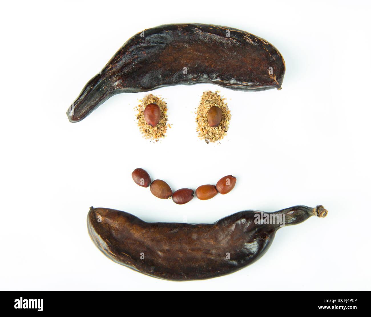 Carob healthy smile - Stock Image