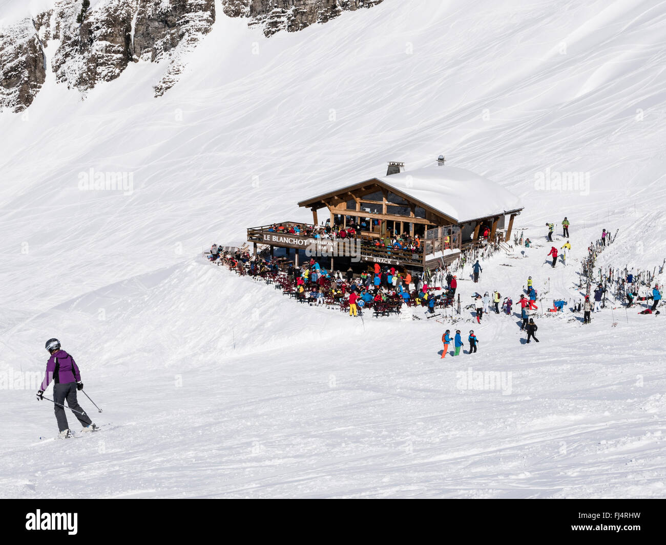 Le Blanchot Alpine ski restaurant busy with skiers on snow slopes in Le Grand Massif ski area of French Alps. Flaine, Stock Photo