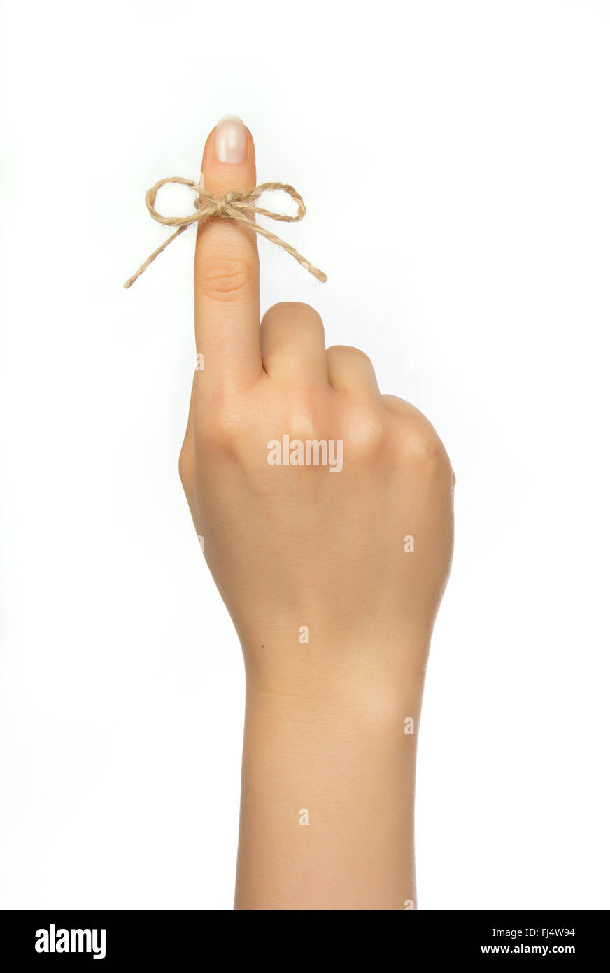 Woman's hand  with reminder string around pointing finger - Stock Image