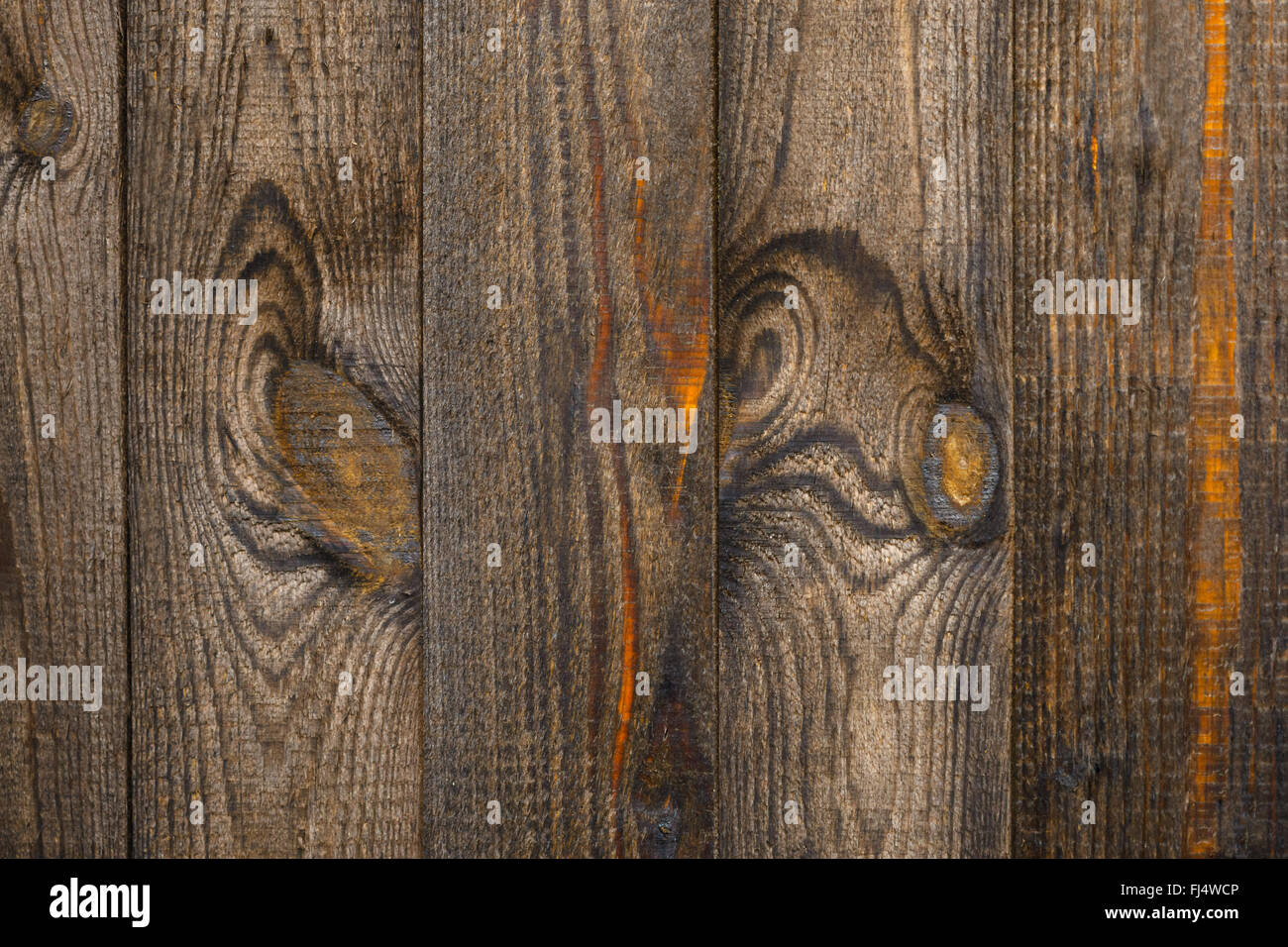 fragment of an old brown wooden fence texture - Stock Image