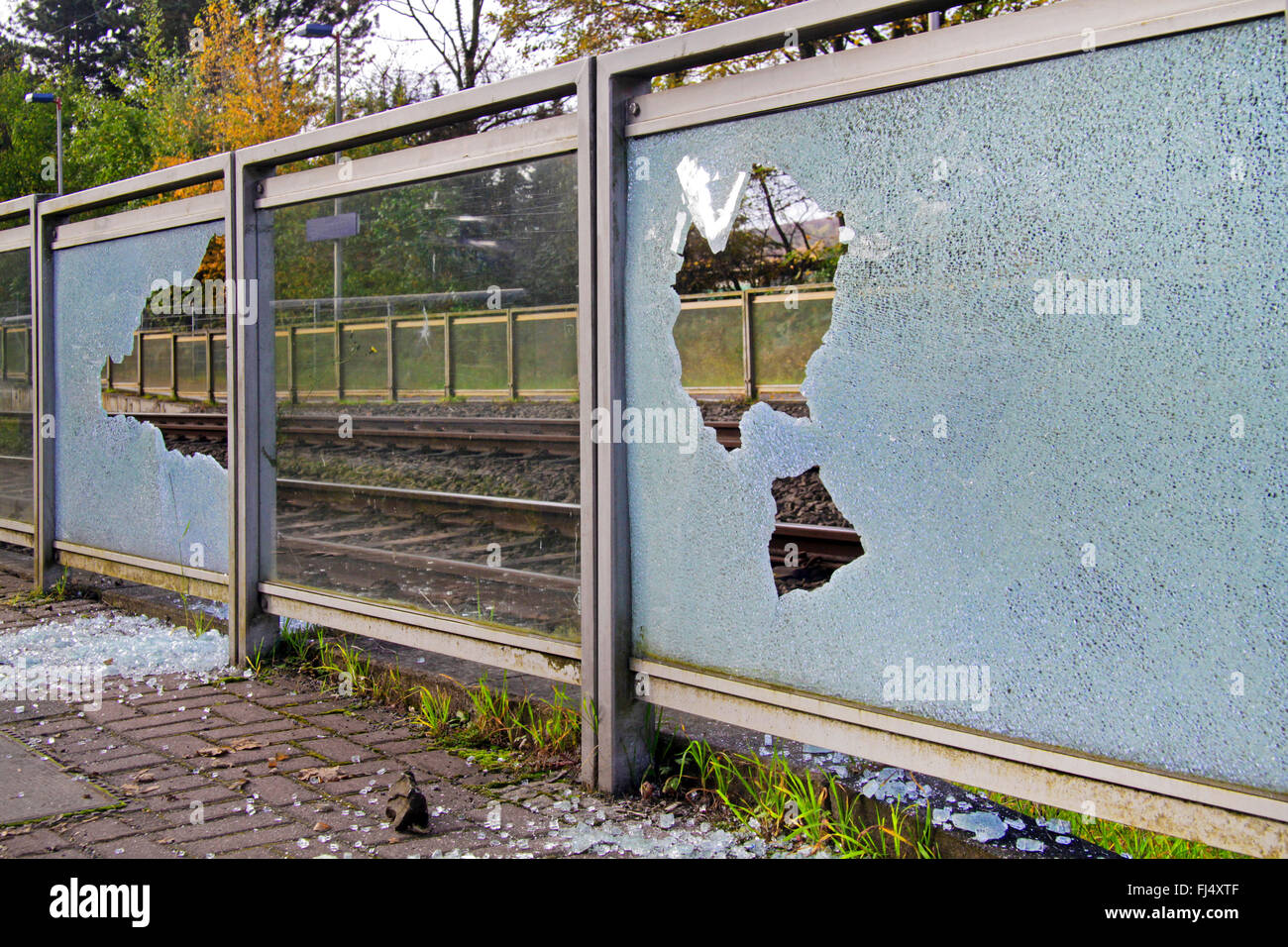 glass breakage caused by vandalism at a train station, Germany - Stock Image