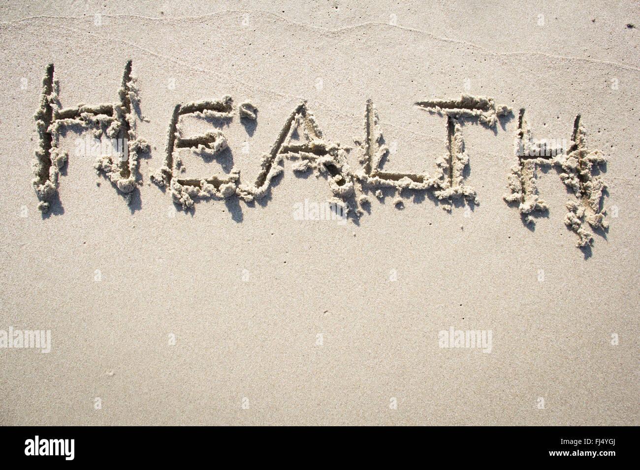 'Health' written in sand - Stock Image
