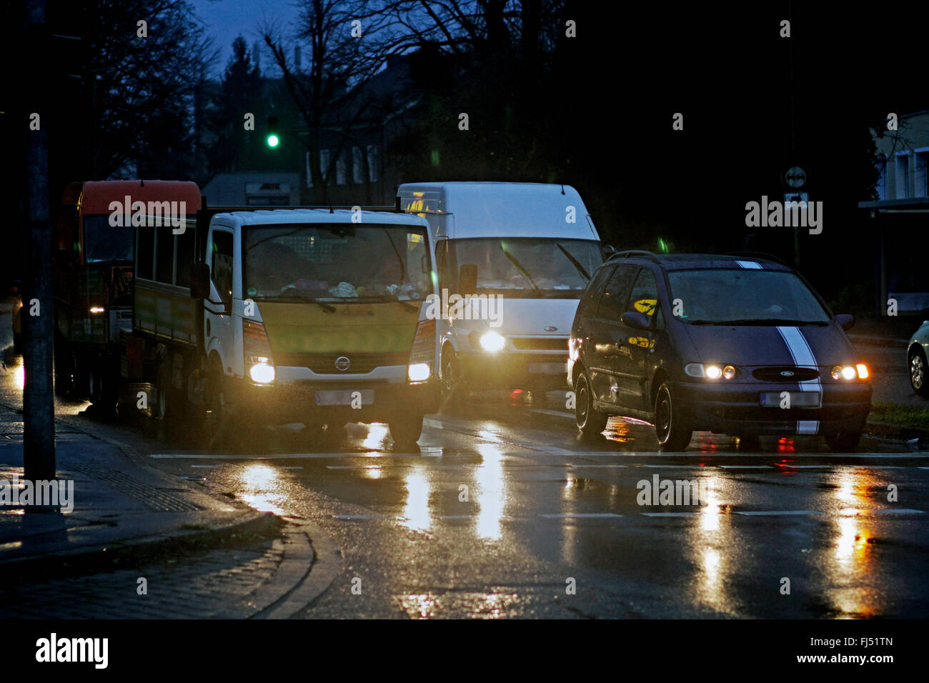traffic in bad weather in the evening, Germany - Stock Image