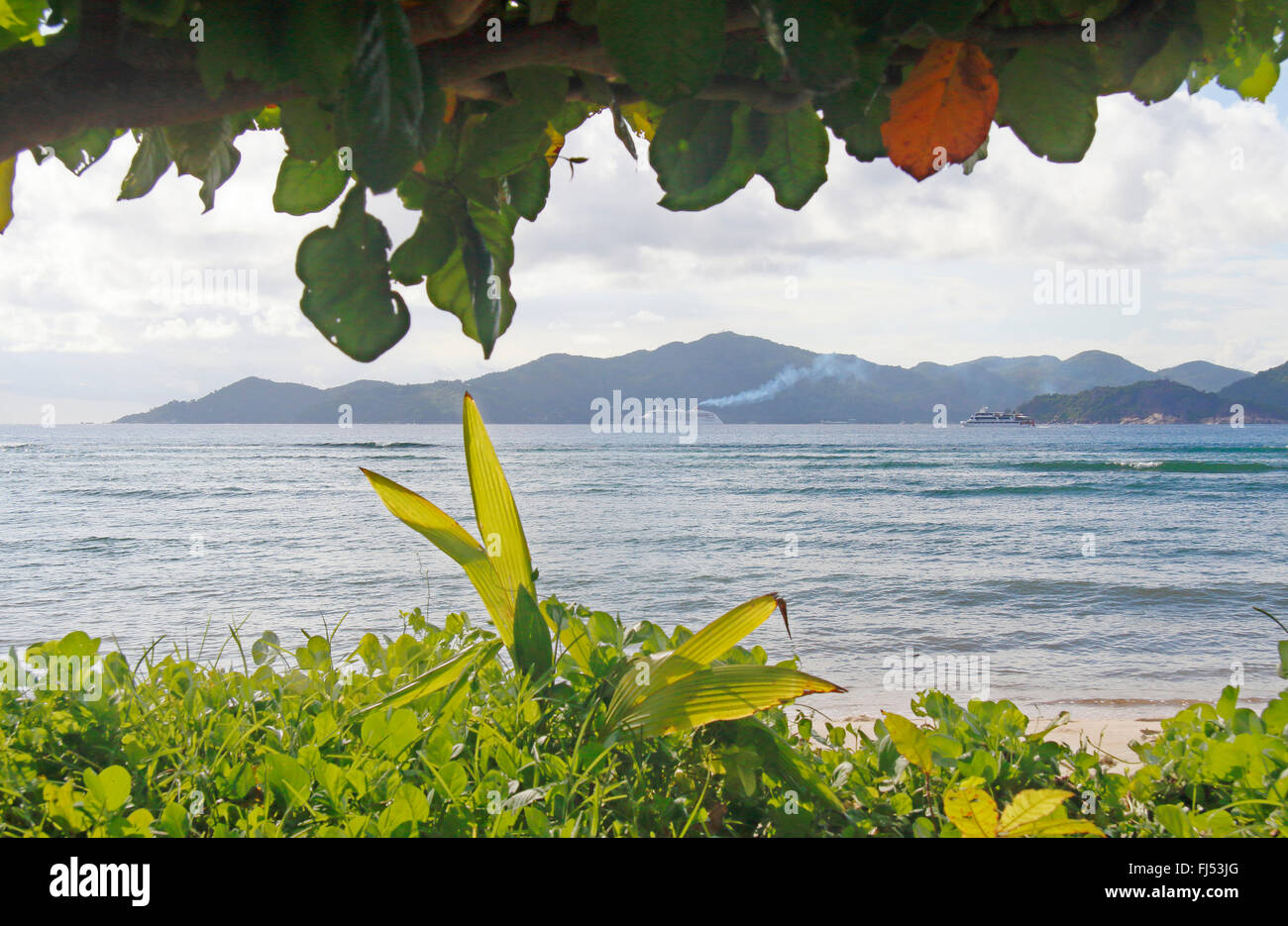 view over the sea onto the island praslin , Seychelles, La Digue - Stock Image