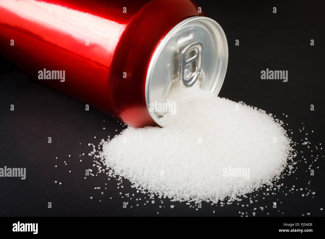 Unhealthy food concept - sugar in carbonated drinks. High amount of sugar in beverages - Stock Image