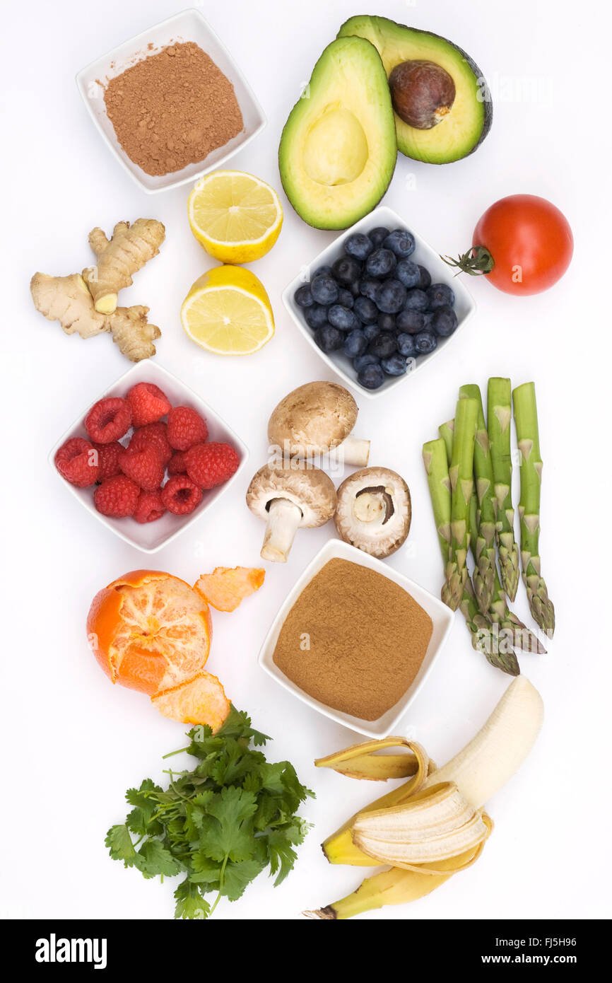 An assortment of healthy, fresh foods on a white background. - Stock Image