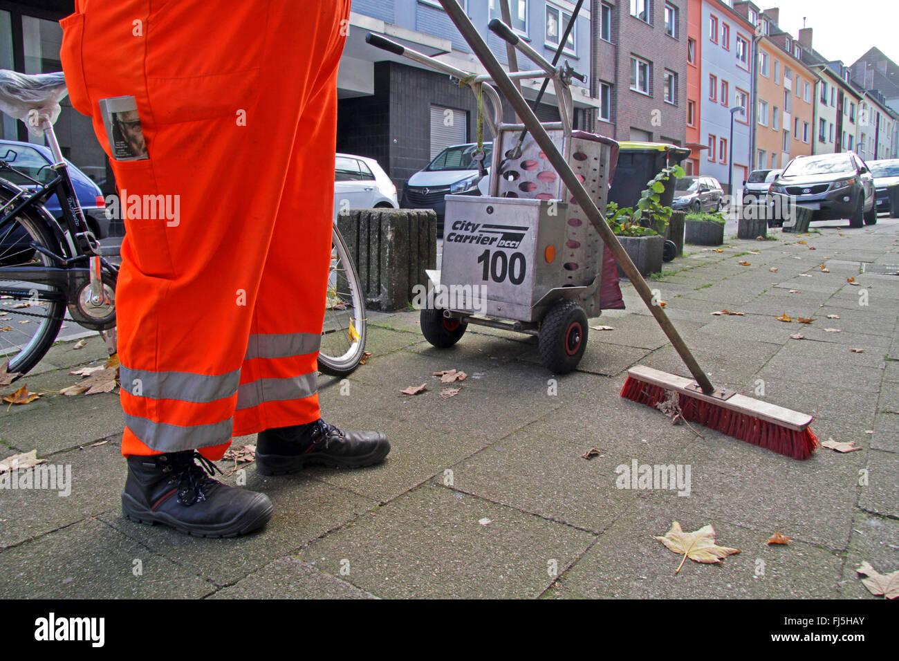 street cleaner sweeping the sidewalk, Germany - Stock Image