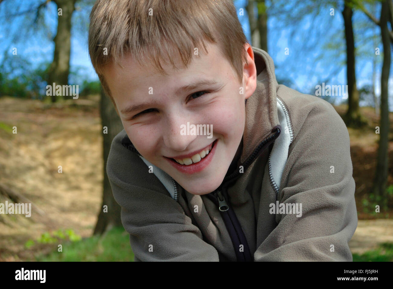 jolly boy in a forest, portrait of a child, Germany Stock Photo
