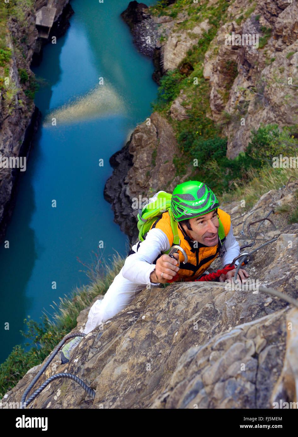 climber on via ferrata over the lake of Sautet, France, Corps - Stock Image