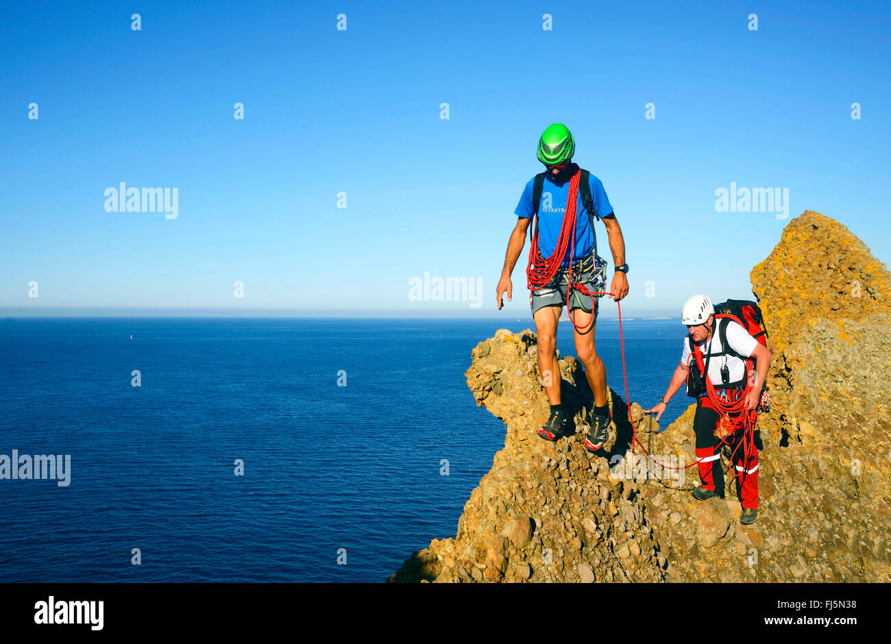two climbers on the top of the Bec de l'Aigle mountain, France, Provence, Calanques National Park, La Ciotat Stock Photo