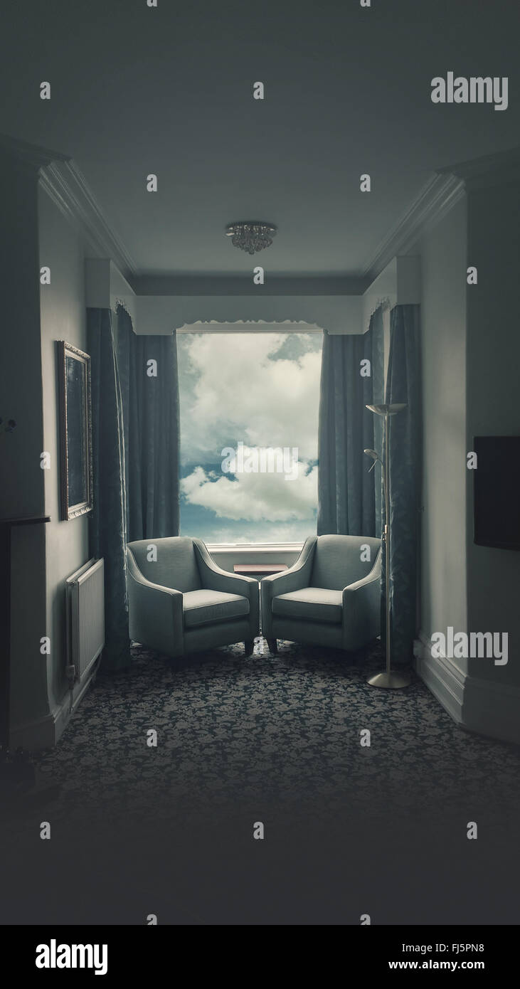 atmospheric hotel room with two armchairs facing each other - Stock Image
