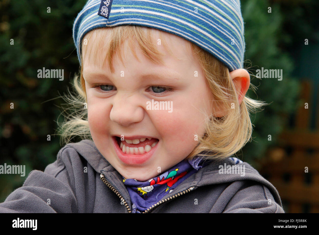 little boy is in bad temper, portrait of a child, Germany - Stock Image