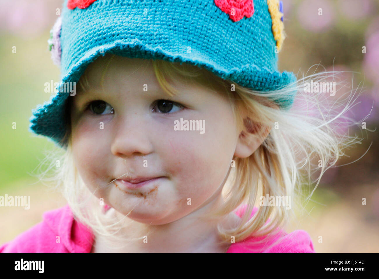 little girl with crochet cap, portrait of a child, Germany - Stock Image