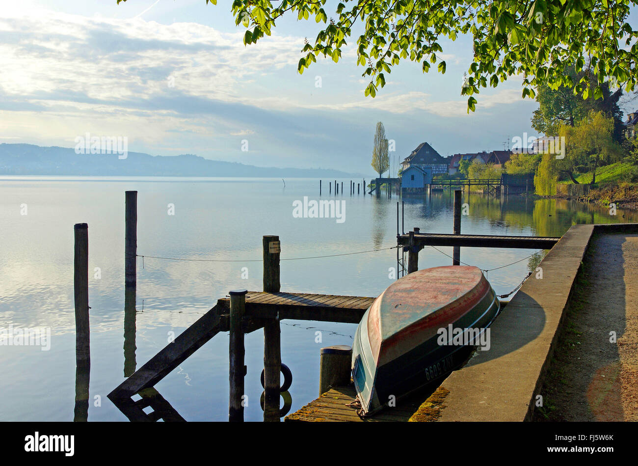landing stage with rowboat at the Bodensee, Germany, Baden-Wuerttemberg, Bodman-Ludwigshafen Stock Photo