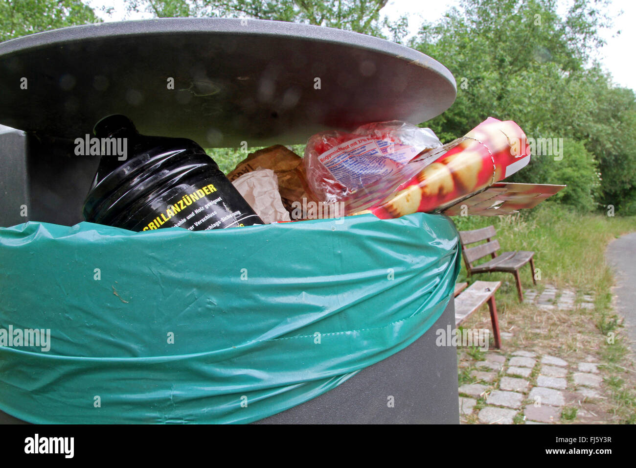 dustbin with charcoal lighter in a nature reserve, Germany - Stock Image