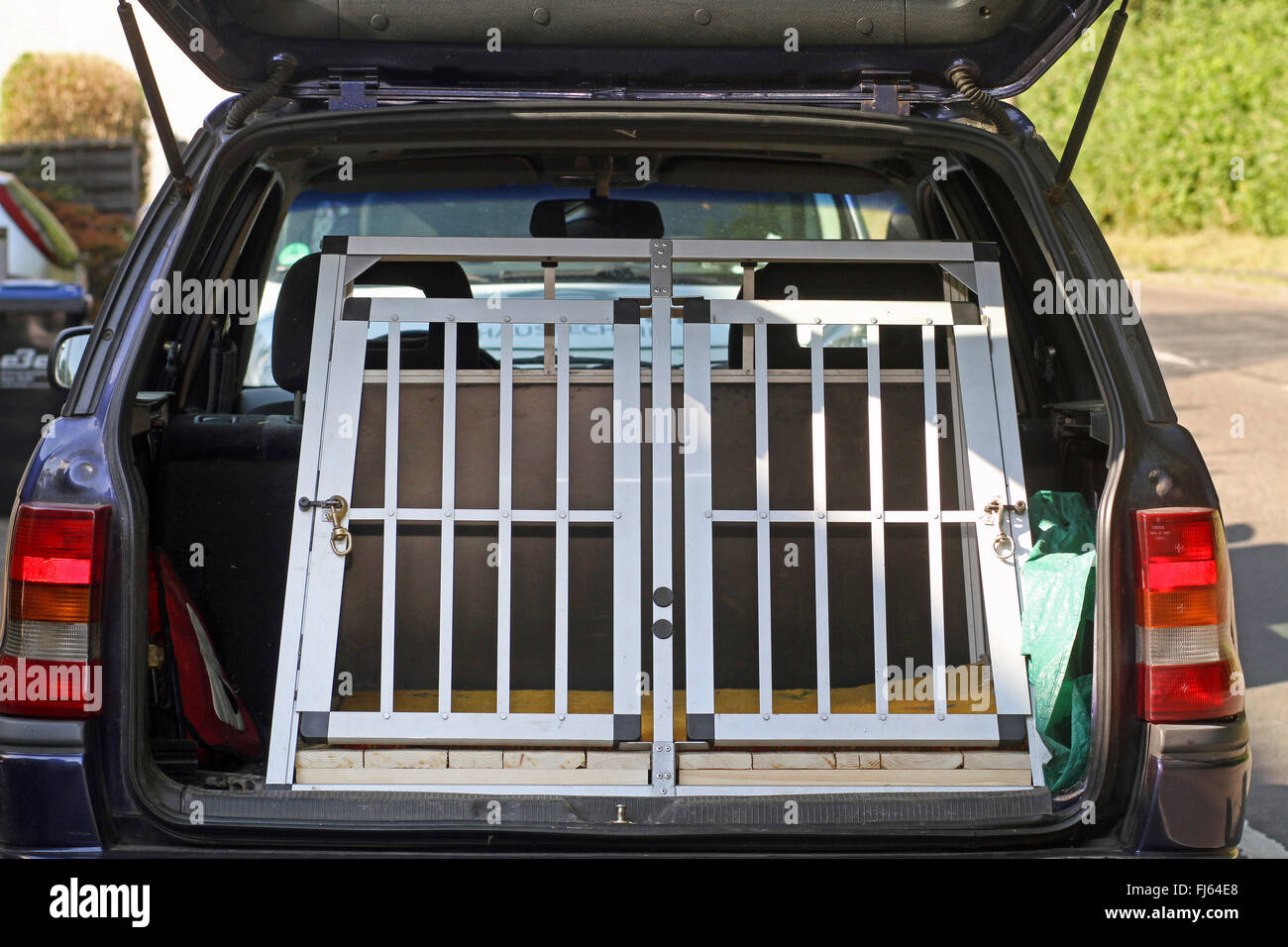 dog transport box in a car boot, Germany - Stock Image