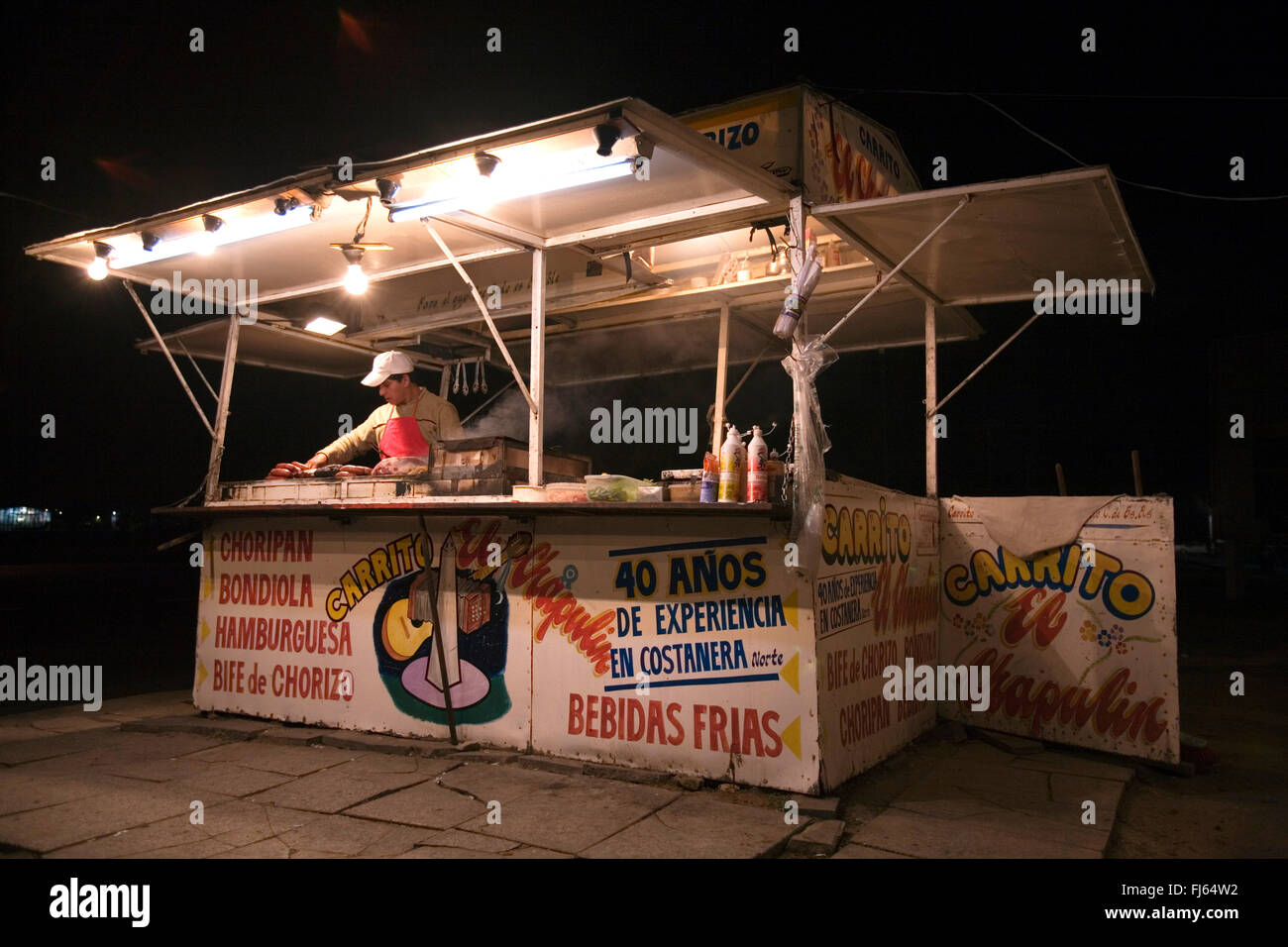 snack food stall at night - Stock Image