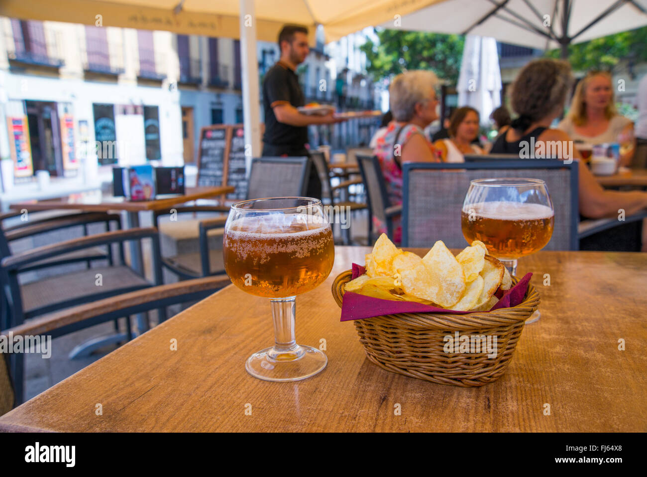 Two Glasses Of Beer And Chips In A Terrace Ramales Square