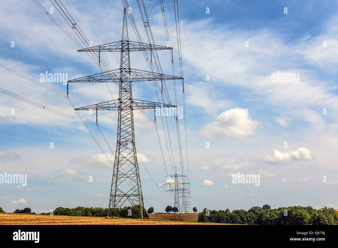 high-tension lines in field landscape, Germany, Bavaria, Oberbayern, Upper Bavaria - Stock Image