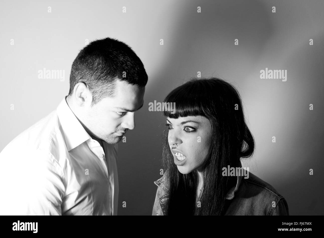 Human relations: young couple having an argument. Black & White. - Stock Image